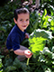 Manzo student harvests chard in the school garden. Photo by Moses Thompson