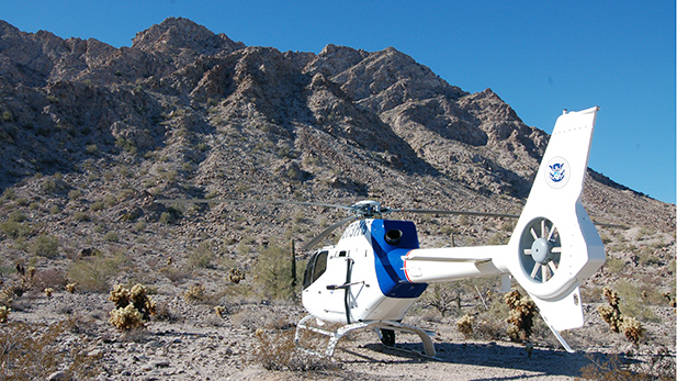 An Air and Marine EC-120B helicopter rests in Sunday Pass in Arizona's southwest desert, in 2009.