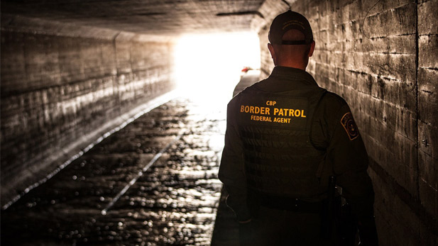 Border Patrol agents inspects a water drainage tunnel that spans from Nogales, AZ into Mexico.