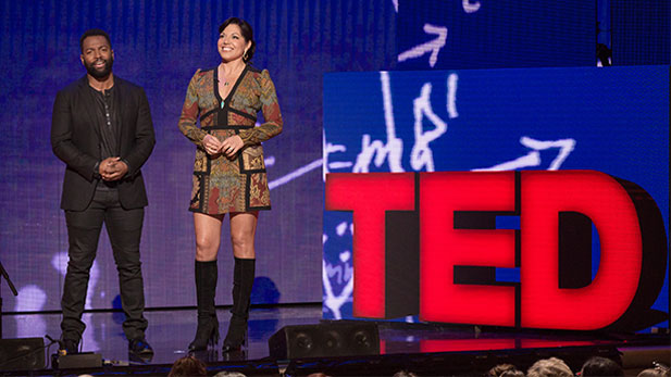 Host Baratunde Thurston and Sara Ramirez speak at TED Talks: Education Revolution, The Town Hall.
