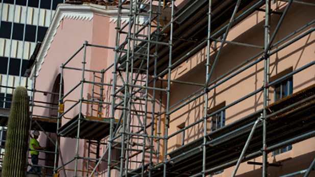 Work crews paint the old Pima County Courthouse building from a muted pink color (left) to it's original, more earth-tone tan color in early 2017.