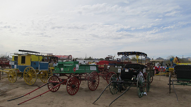 Some of the horse-drawn vehicles in the 2014 Tucson Rodeo Parade, including fringe-top surreys.