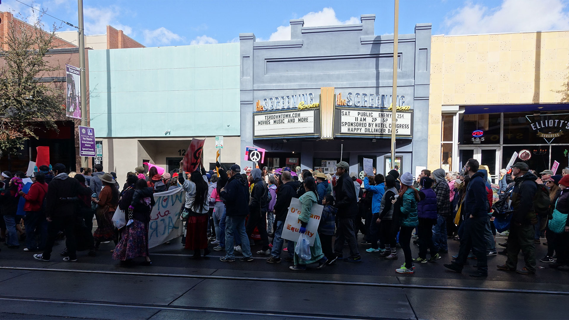 People at the Tucson's Women's March as it passes by the Screening Room in downtown Tucson, Jan. 21, 2017.