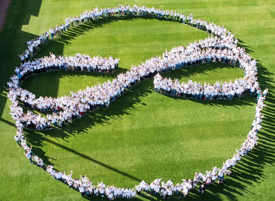 Tucsonans form an 'embrace' symbol to commeorate victims of the Jan. 8, 2011 mass shooting.