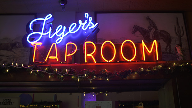 A neon sign for Tiger's Tap Room at Hotel Congress.