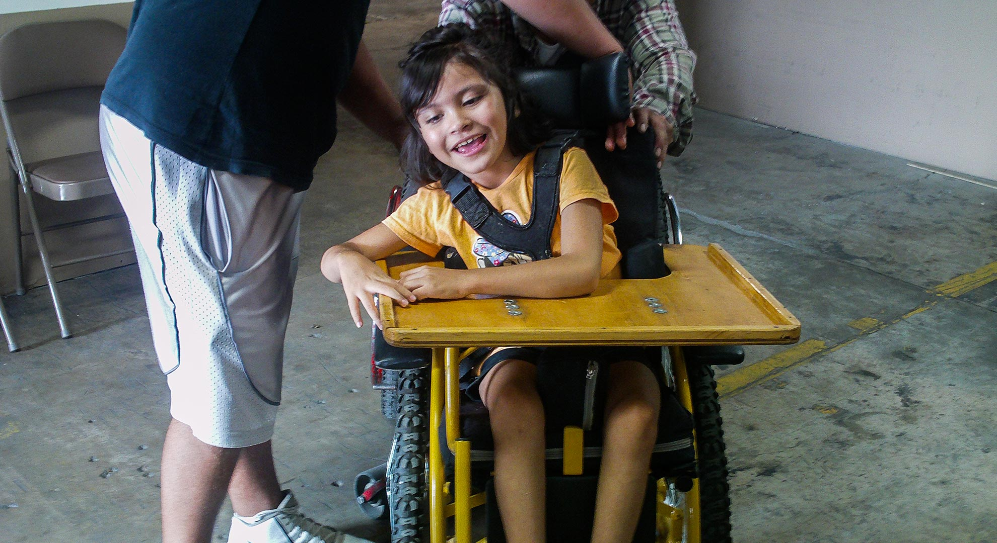A child gets her first wheelchair built by ARSOBO, a nonprofit in Nogales, Sonora.