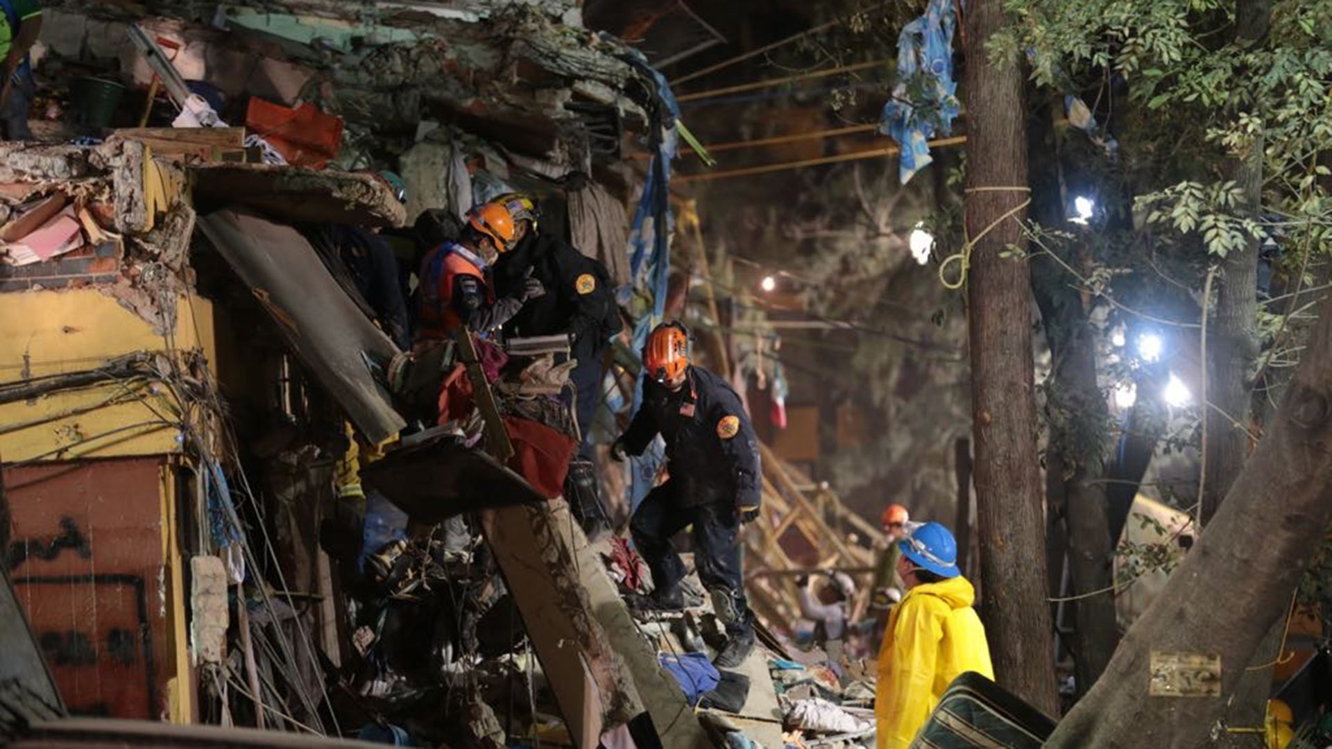 U.S. rescuers from the Disaster Assistance Response Team (DART) climb a collapsed building in Mexico City after the earthquake of Sept. 19, 2017.