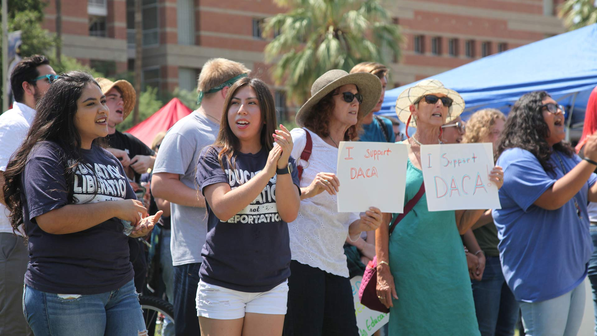 Perla Rojas (left) and Ana Mendoza (center) were among the DACA recipients who gathered on the University of Arizona mall Tuesday afternoon.