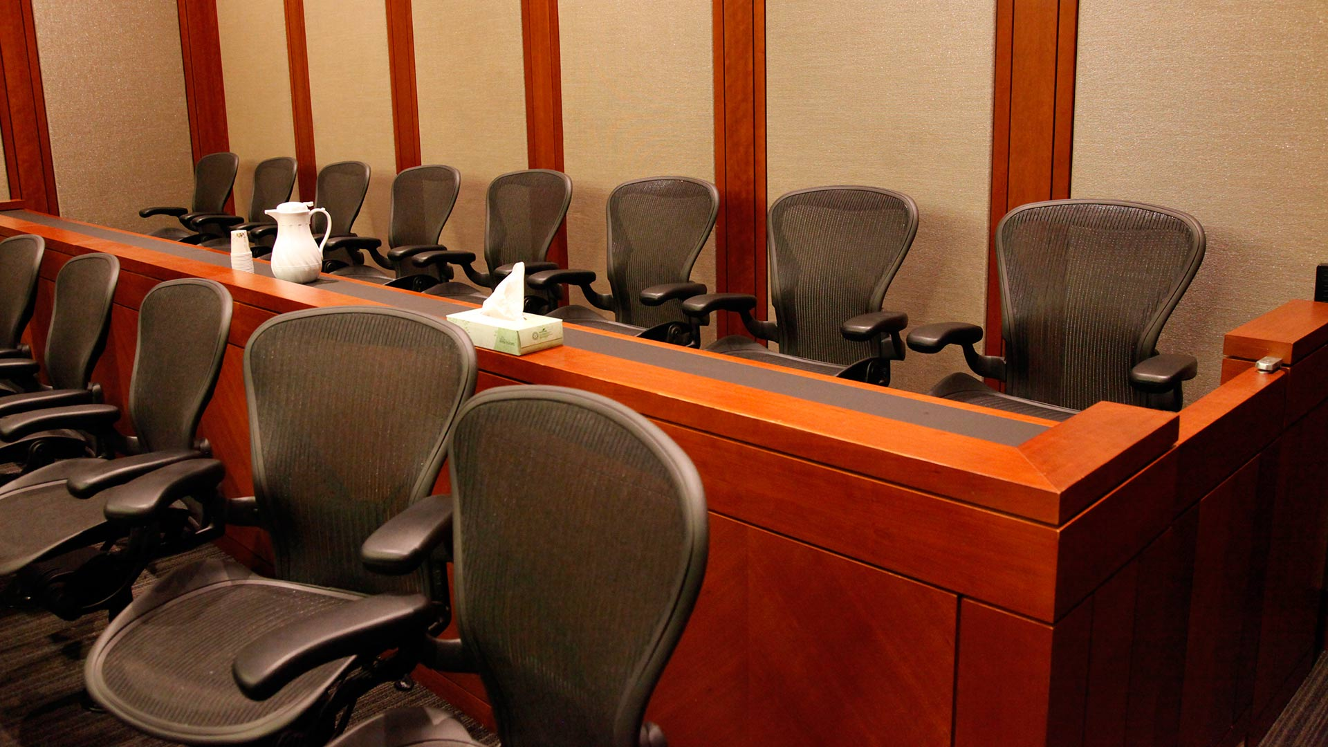 Empty seats await their jurors.