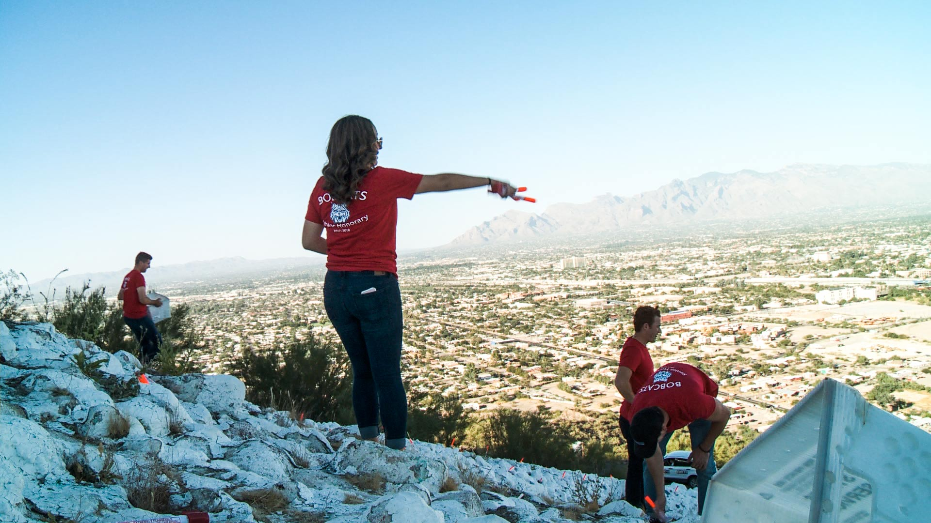 "University of Arizona students prepare ""A"" Mountain for a homecoming tradition."
