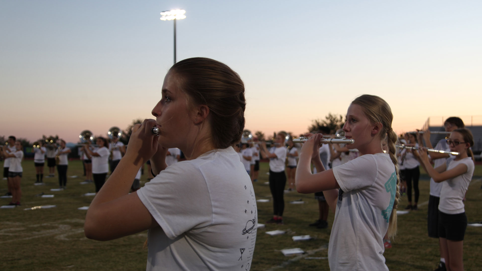 The marching band attracts students from all grades who play various instruments.