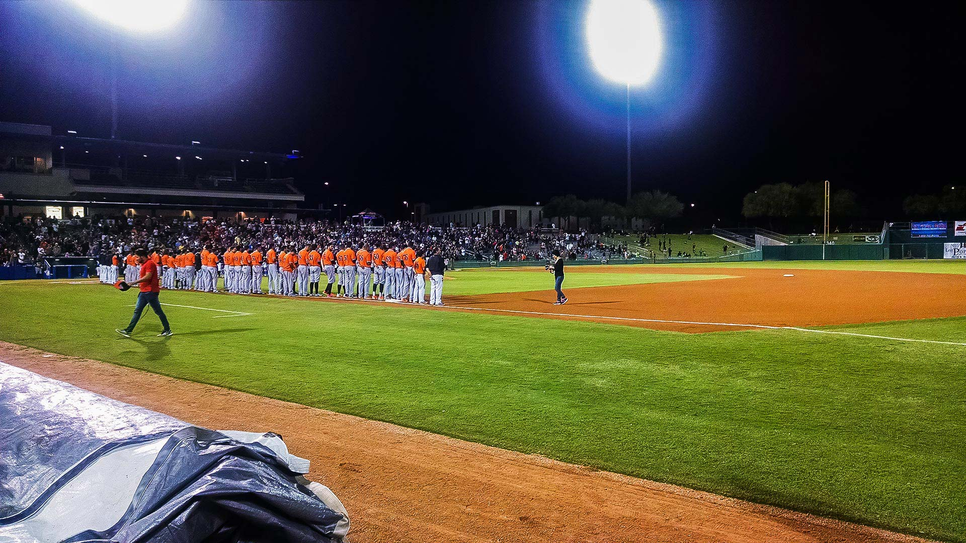 The Naranjeros of Hermosillo, Mexico, line up for the national anthems of Mexico and the U.S. during the Mexican Baseball Fiesta in Tucson, Sept. 29, 2016.
