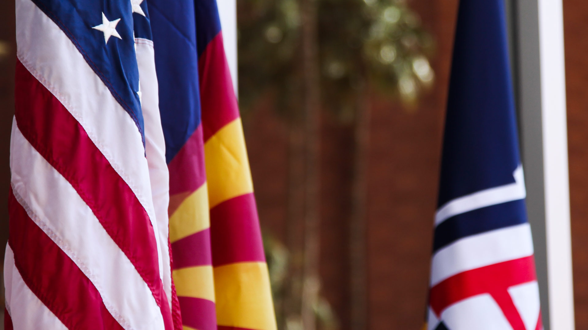 The United States, Arizona and University of Arizona flags.