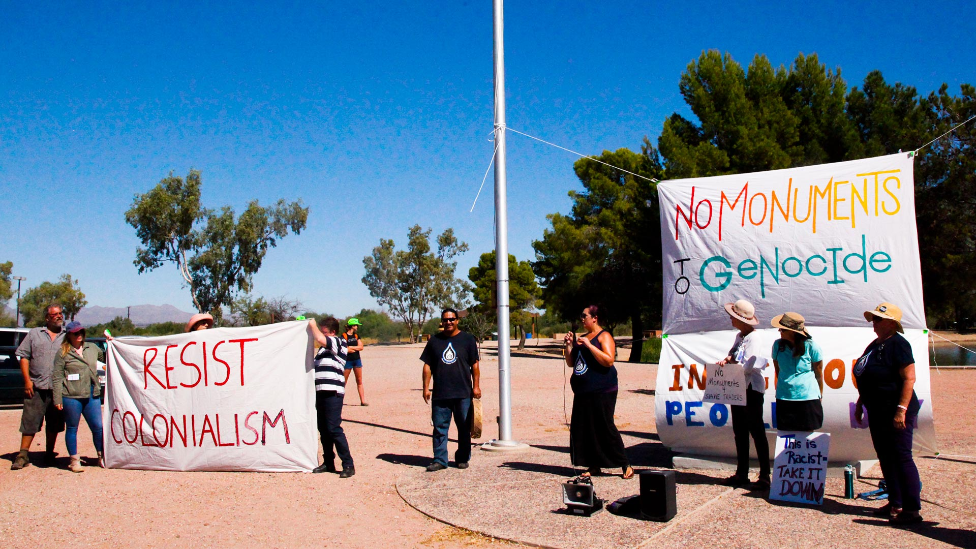 Groups gathered in Tucson's Christopher Columbus Park Oct. 8, 2017, to demand the city change the name.
