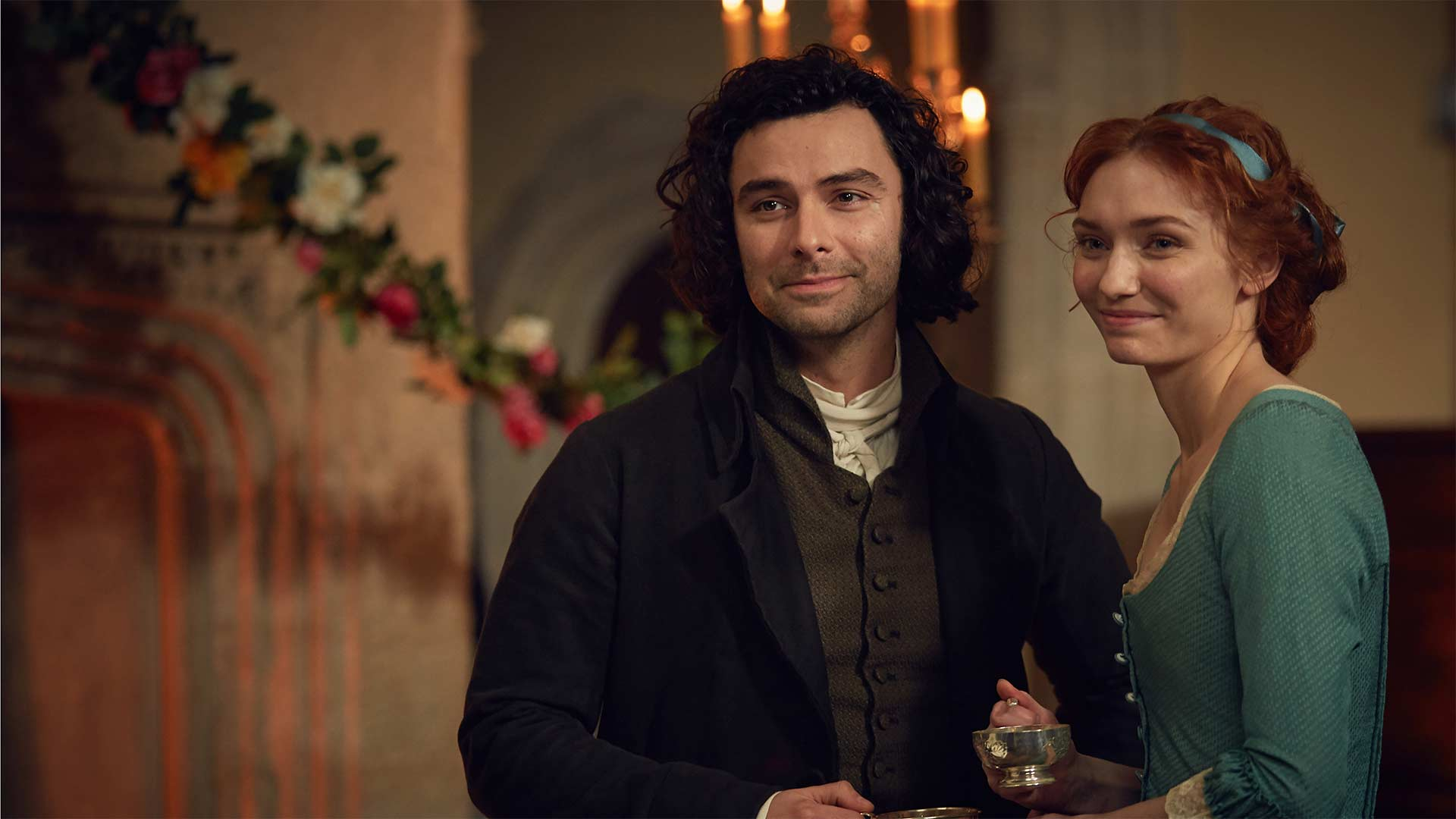Aidan Turner as Ross Poldark and Eleanor Tomlinson as Demelza Poldark