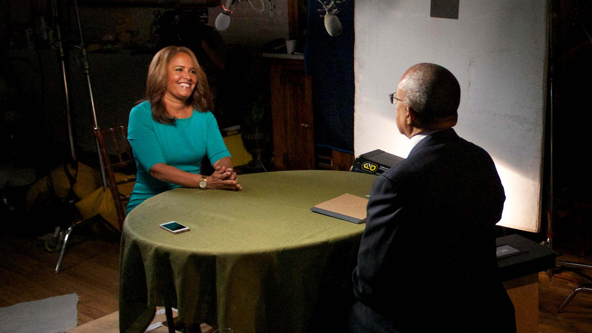 Henry Louis Gates, Jr. with Suzanne Malveaux on the set of FINDING YOUR ROOTS, season 4