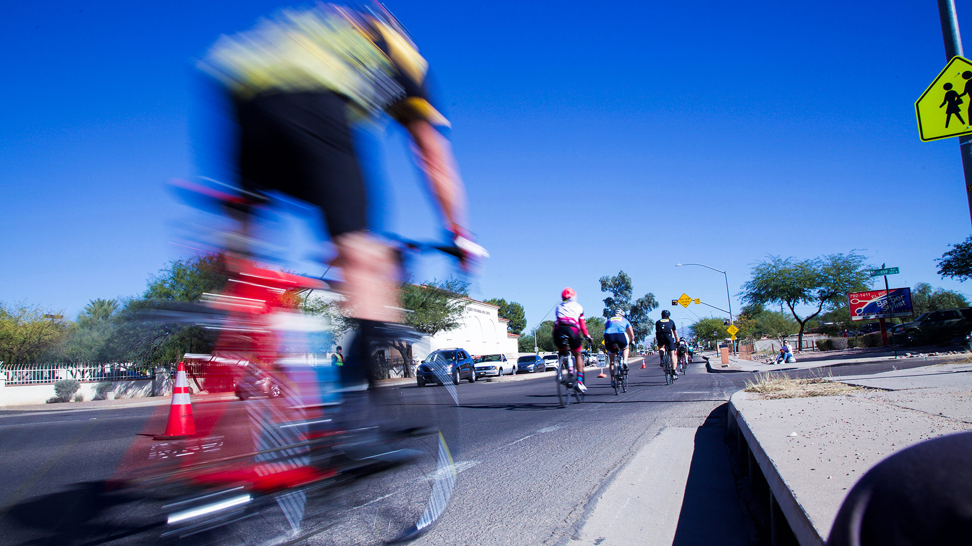 Cyclists ride east on Speedway Boulevard for El Tour de Tucson in 2017.