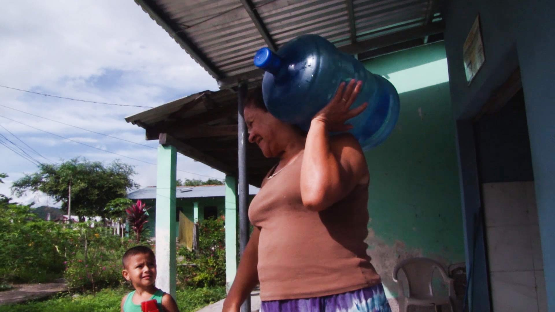 A woman retrieves potable water in Honduras.