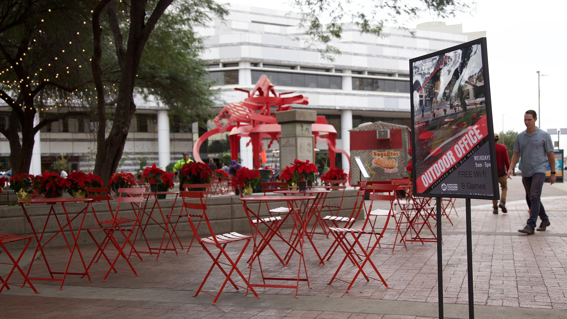 Red tables and lawn games now take up portions of the space under the trees at Jacome Plaza in downtown. The Outdoor Office is open to the public Monday through Friday from 9:00 a.m. to 5:00 p.m.