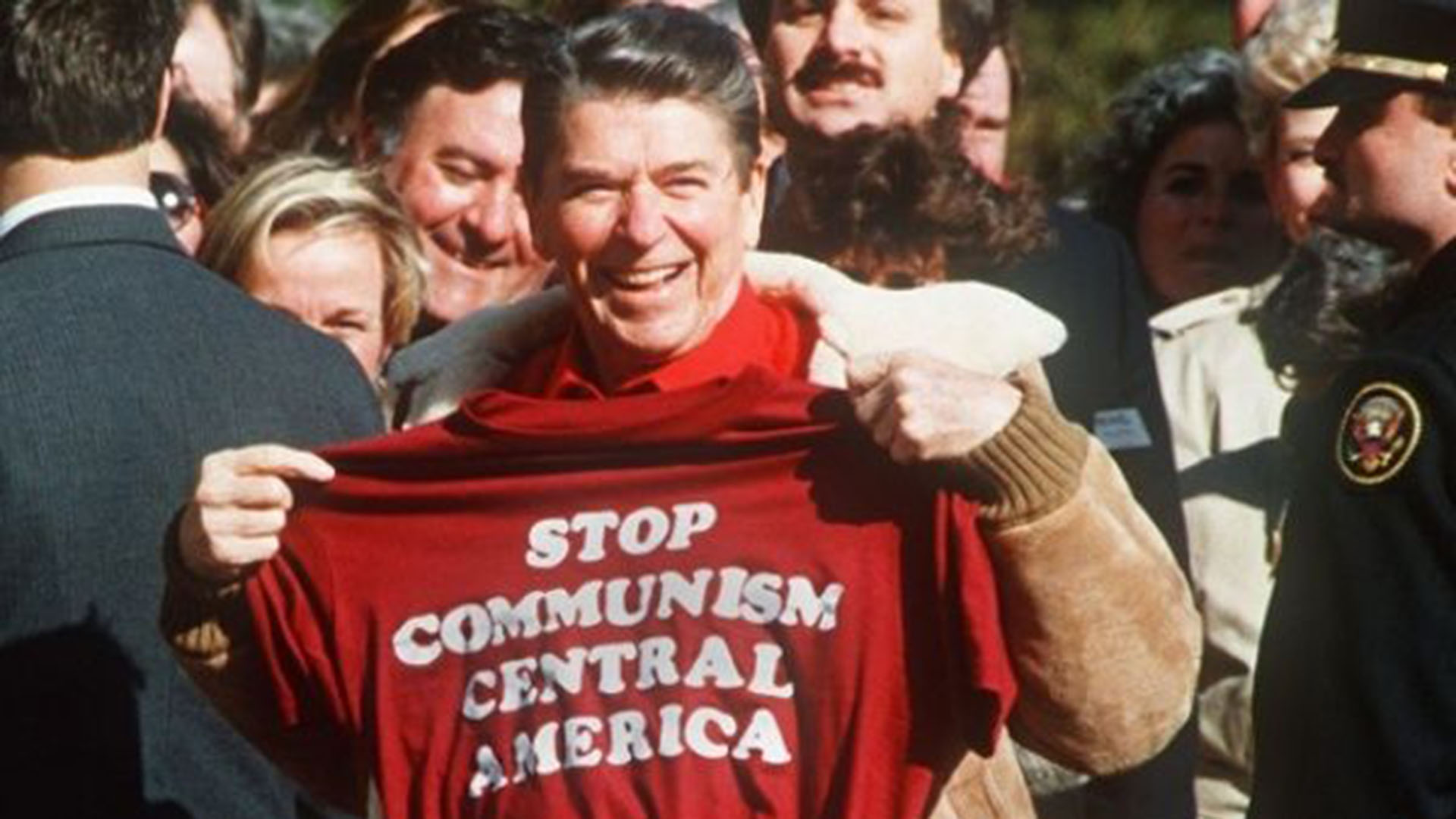 Reagan holds up t-shirt