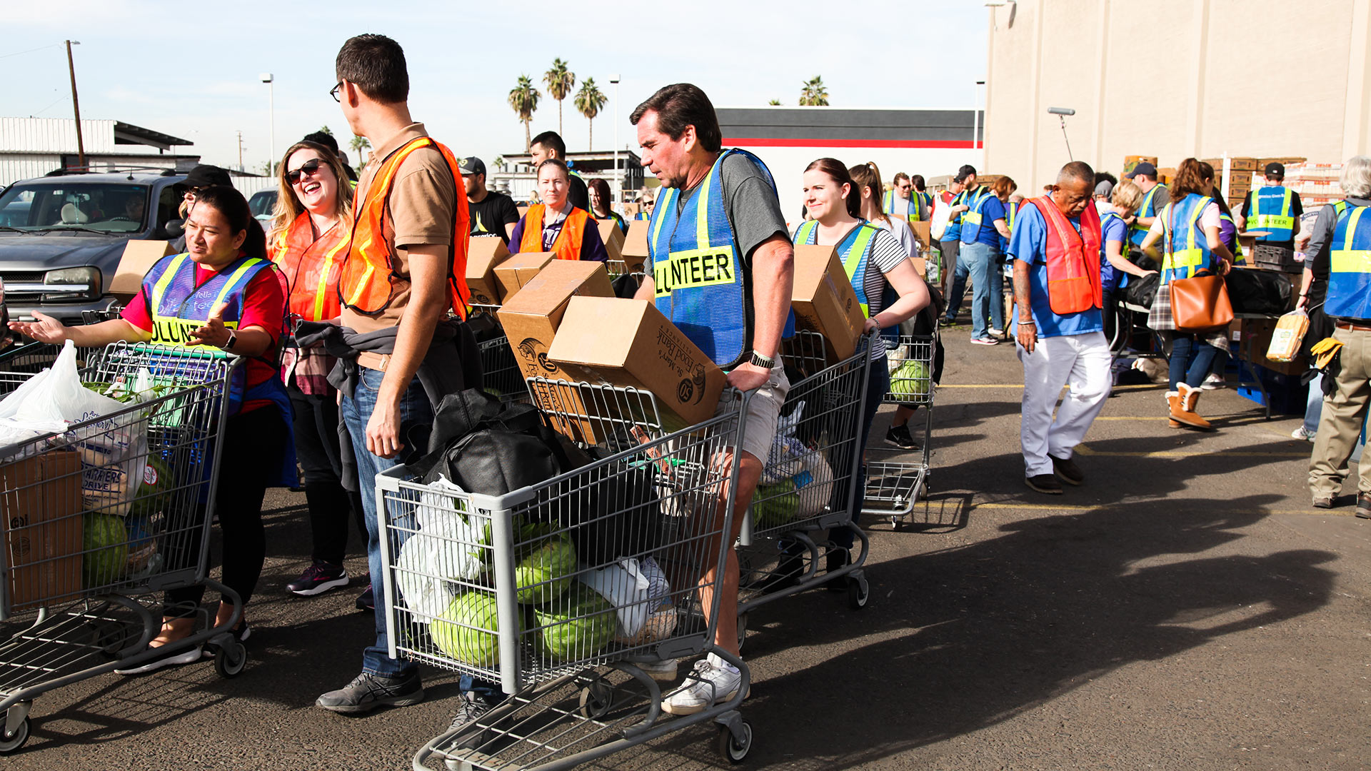 Volunteers distribute Thanksgiving meals at St. Mary's Food Bank Alliance in Phoenix on Monday, Nov. 20.
