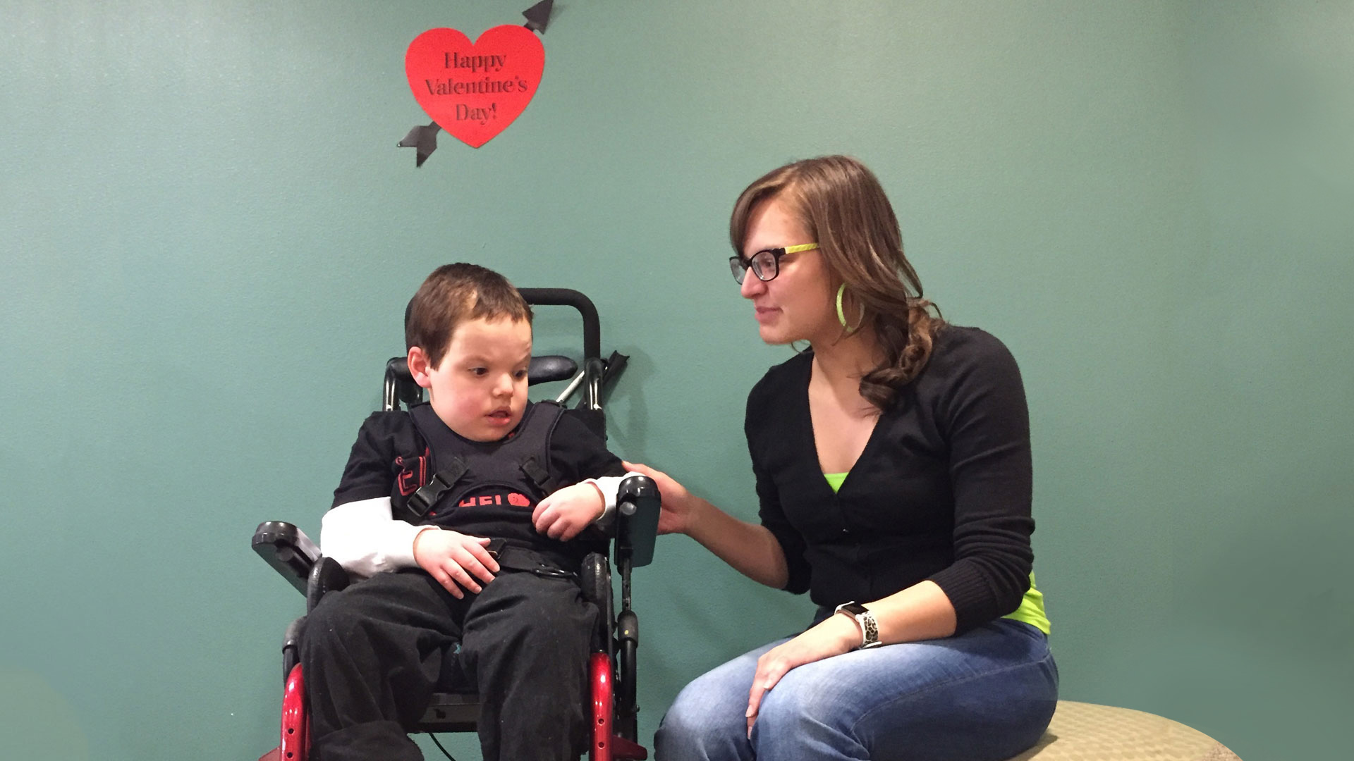 Jaclyn Larson and her son Aidan both have health insurance through Arizona's Medicaid program, AHCCCS.