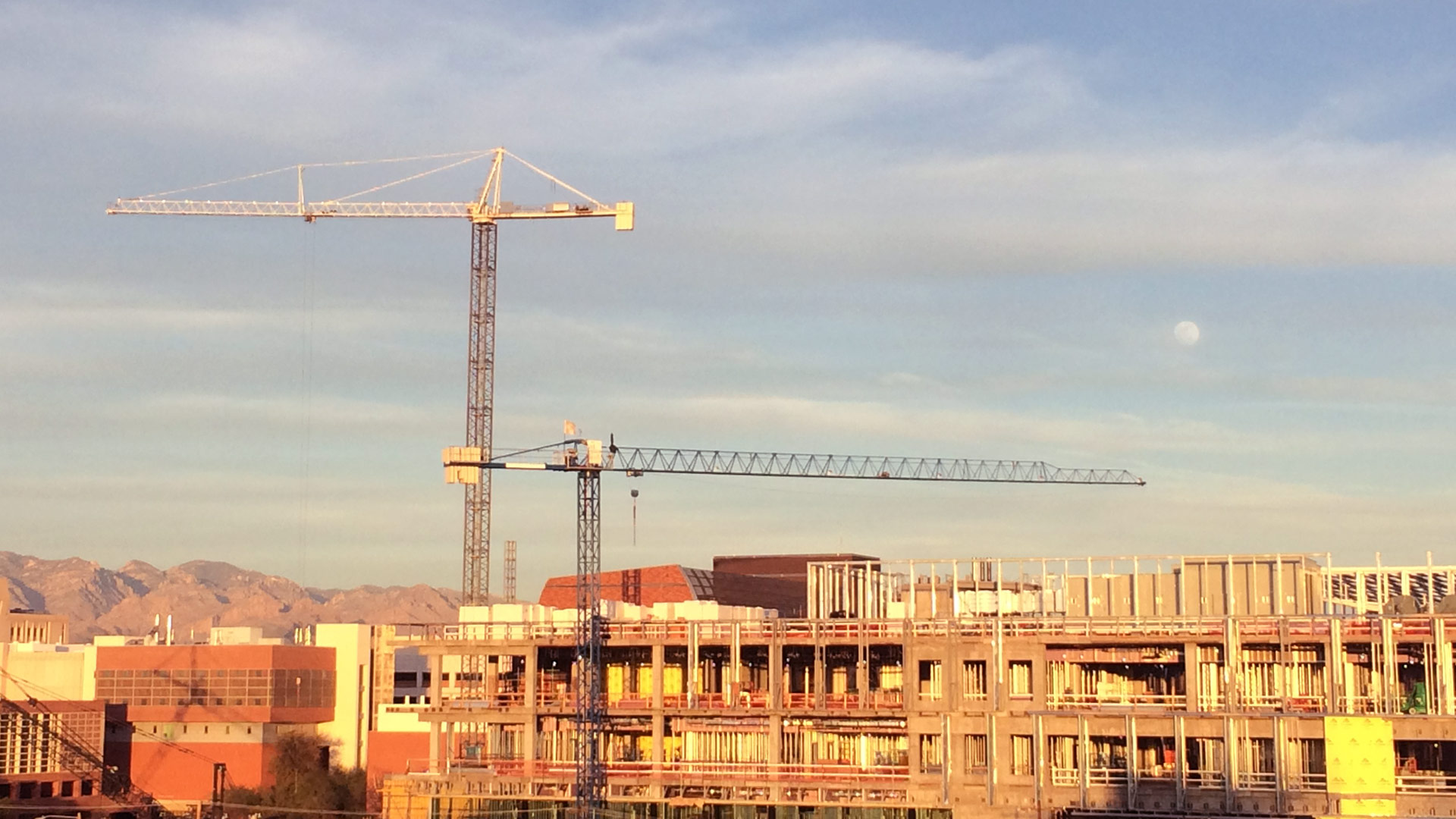 Cranes tower over the construction site at Banner University Medical Center.