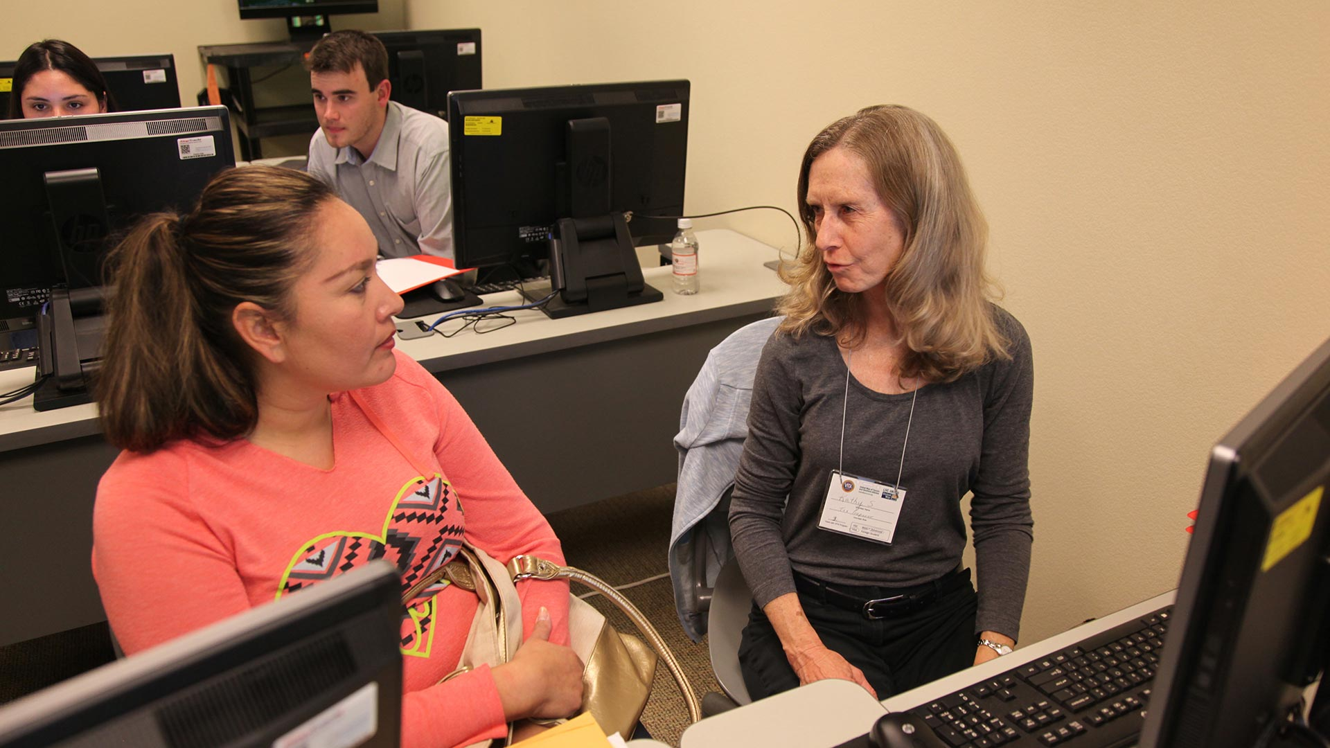 Volunteer tax preparer Katherine Steiner helps a taxpayer prepare her return.