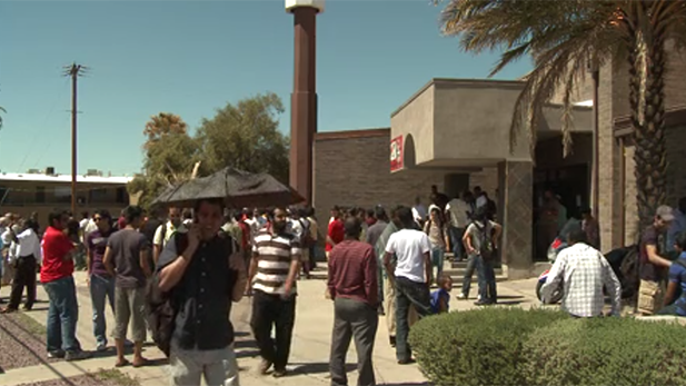 People mill about on a Friday outside of the Islamic Center of Tucson, 2011.