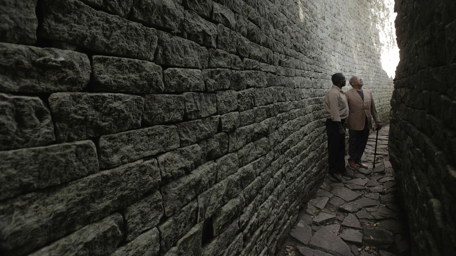 Henry Louis Gates, Jr. and Dr. Edward Matenga take a closer look at Great Zimbabwe, a former capital and ancient city built centuries ago, in Zimbabwe.