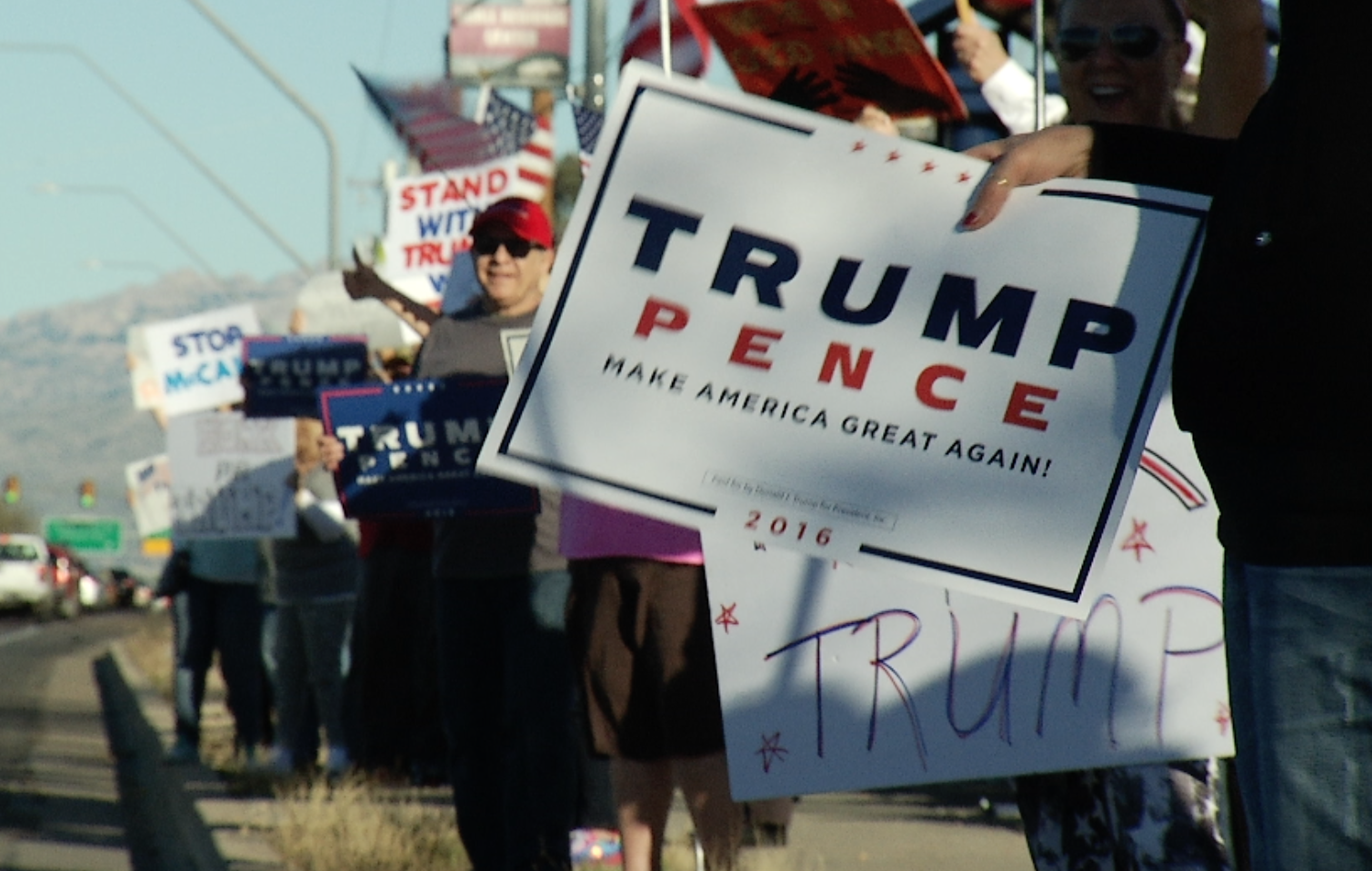 Supporters of President Trump rally along Tucson's Tanque Verde Road, Feb. 22, 2017.