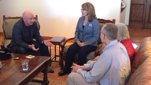 Mark Kelly (left) and Gabrielle Giffords visit in their home with David and Penny Welch, to whom Kelly and Giffords presented Welch's father's World War II Navy uniform, Feb. 13, 2015.