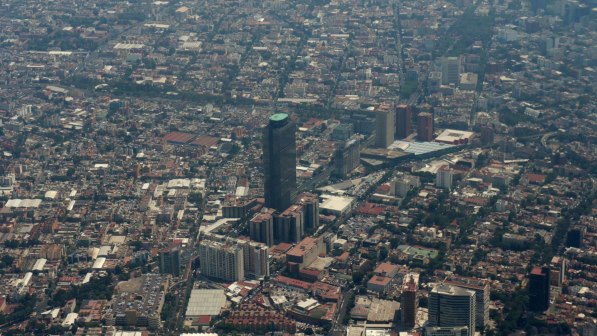 The Pemex Tower stands out in an aerial view of Mexico City.