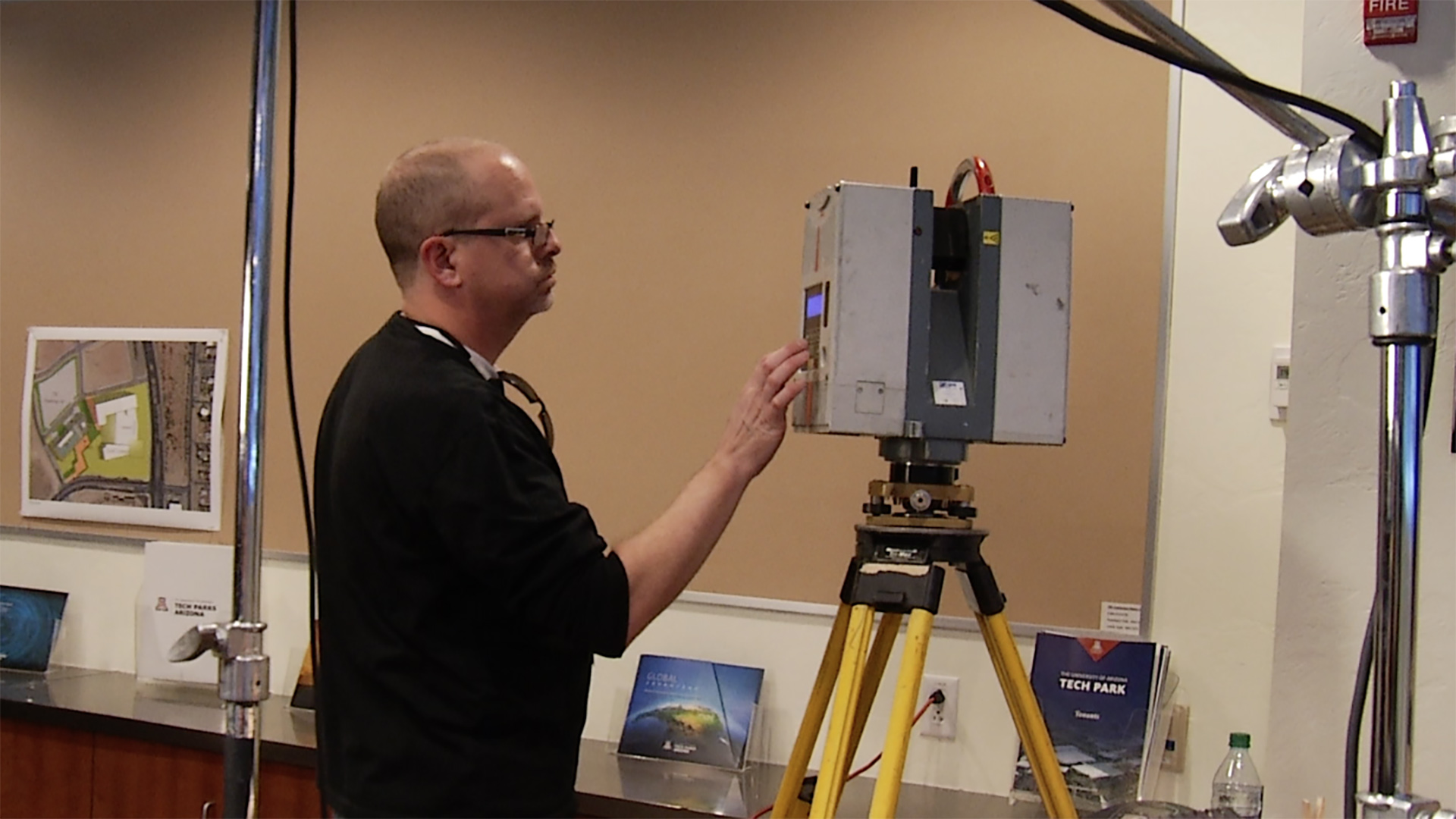 An employee of Darling Geomatics conducts a 3-D scan of a room at the Tech Park on Rita Road.
