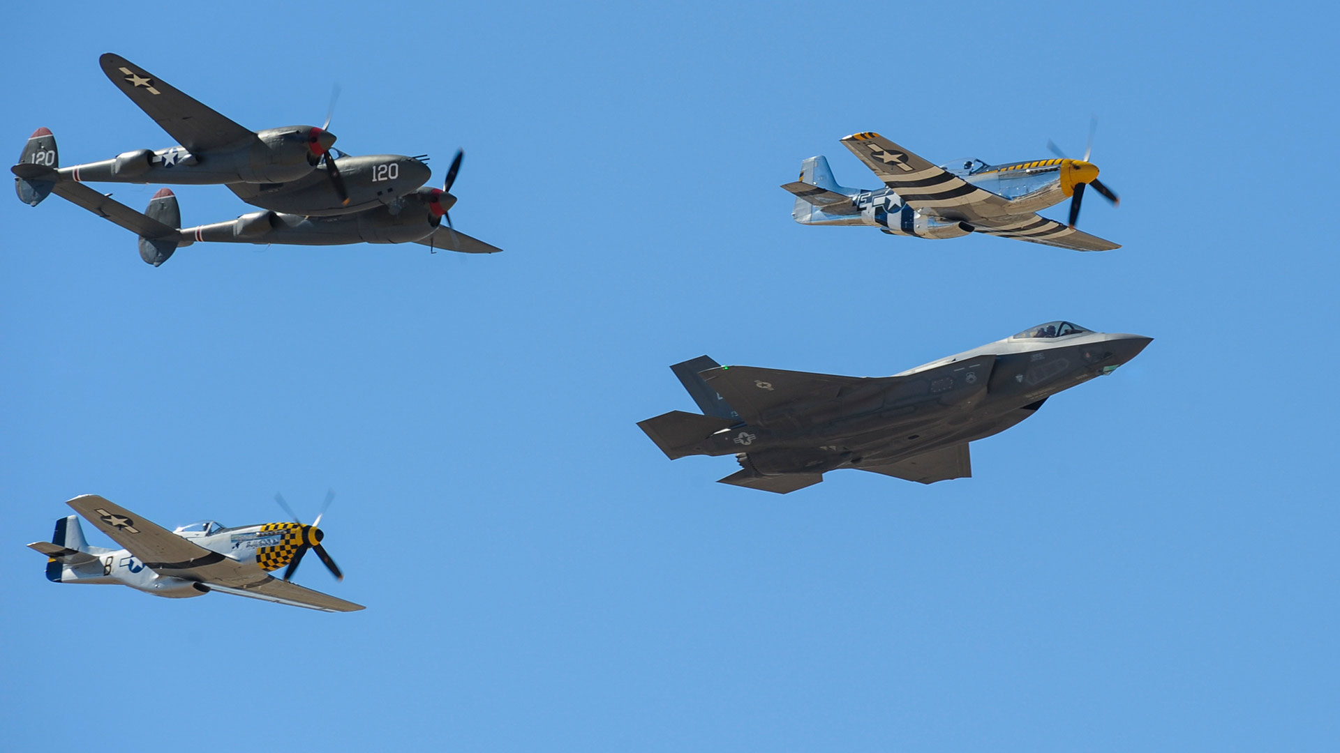 Two P-51 Mustangs, an F-35 Lightning II and a P-38 Lightning fly in formation during the 2016 Heritage Flight Training and Certification Course at Davis-Monthan Air Force Base, Ariz., March 5, 2016.