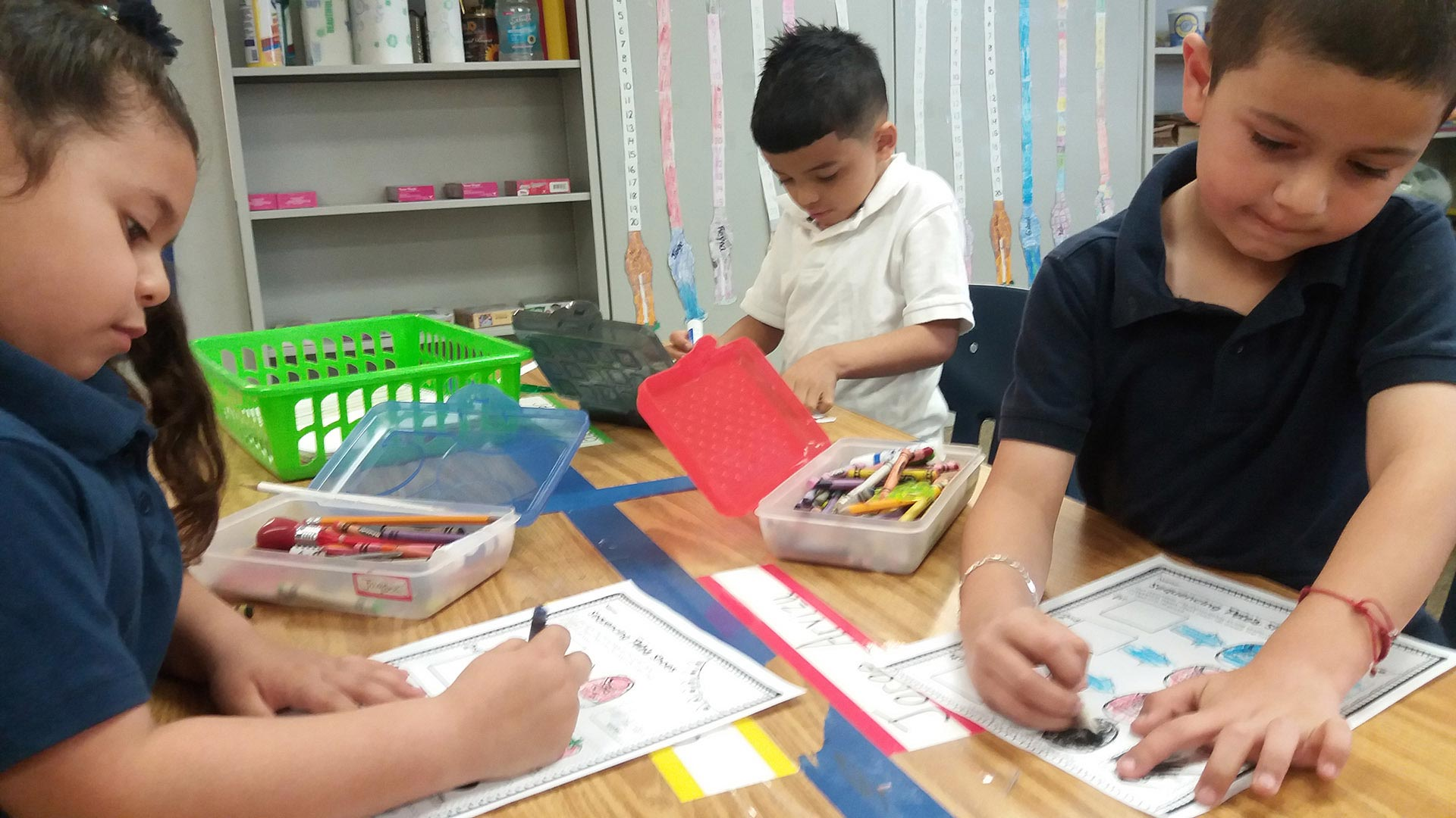 Kindergarteners work on an activity at Nosotros Academy.