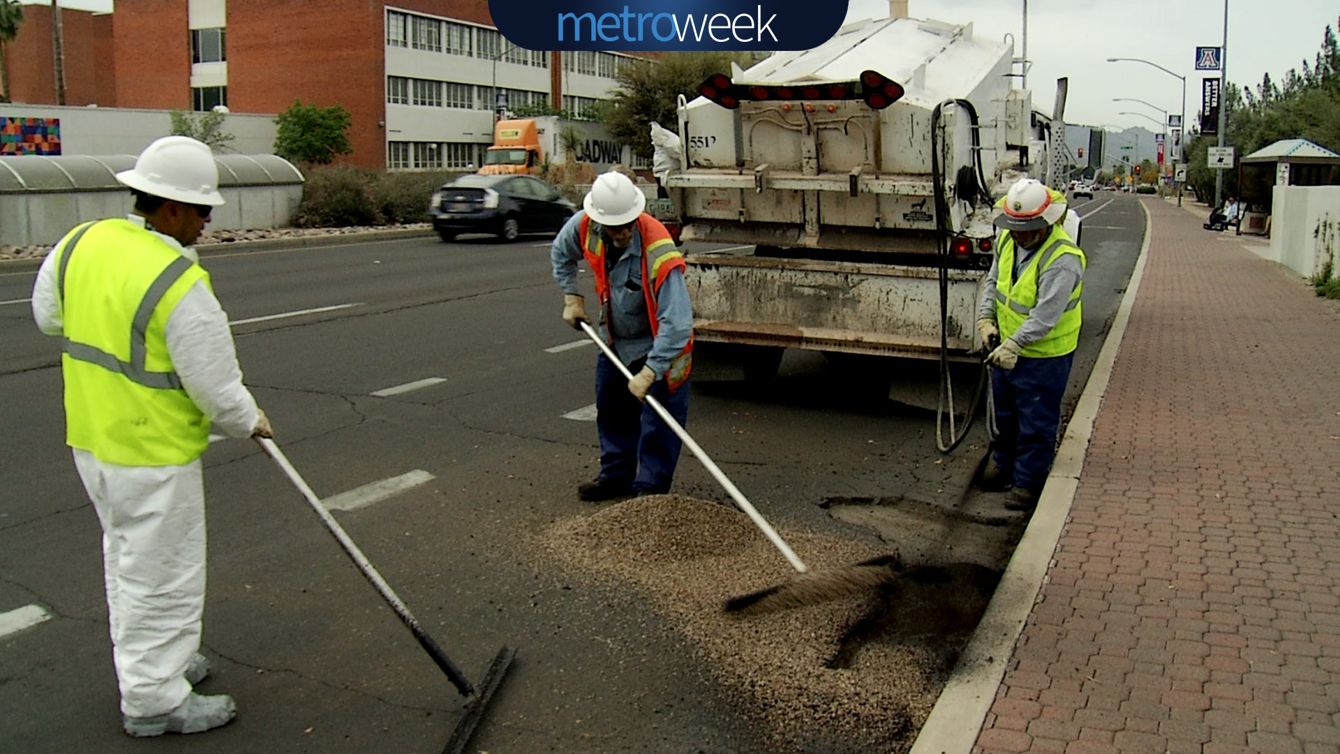 Workers repair a pothole.