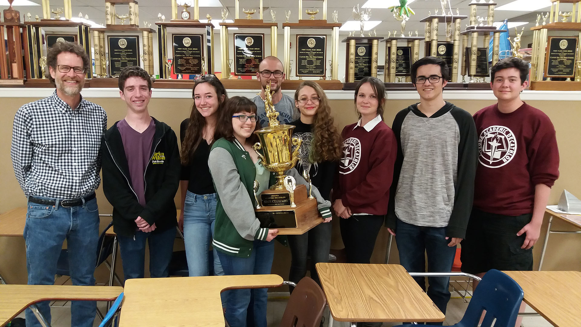 Canyon Del Oro High School's academic decathlon team, from left: Chris Yetman (coach), Brady Lybarger (senior), Chloe Penna (sophomore), Paige Dingman (senior), Albert Windes (junior), Allienna Nezelek (sophomore), Piper Gray (junior), Patrick Carswell (senior), Evan Cuillier (senior).