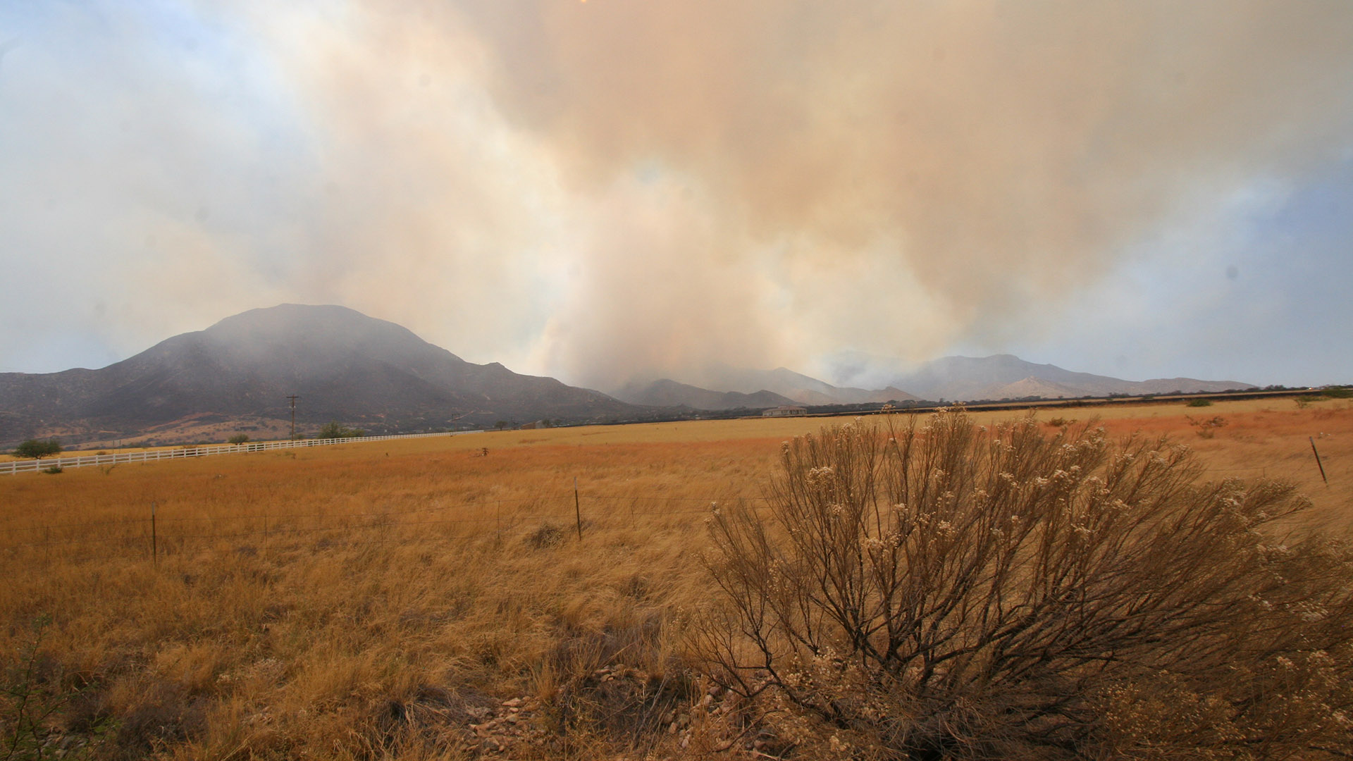 The Wallow Fire burns in the distance, in 2011.