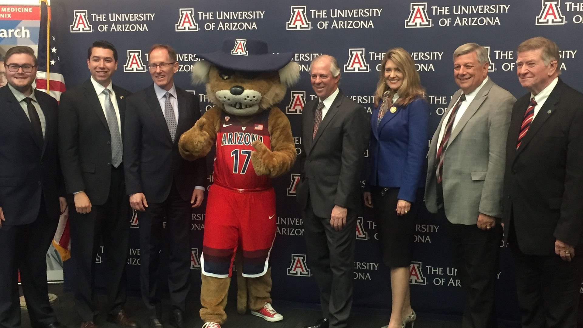 Robert Clayton Robbins, fourth from the right, poses with the University of Arizona mascot and members of the Arizona Board of Regents at the press conference announcing the vote to make him a finalist for UA president.