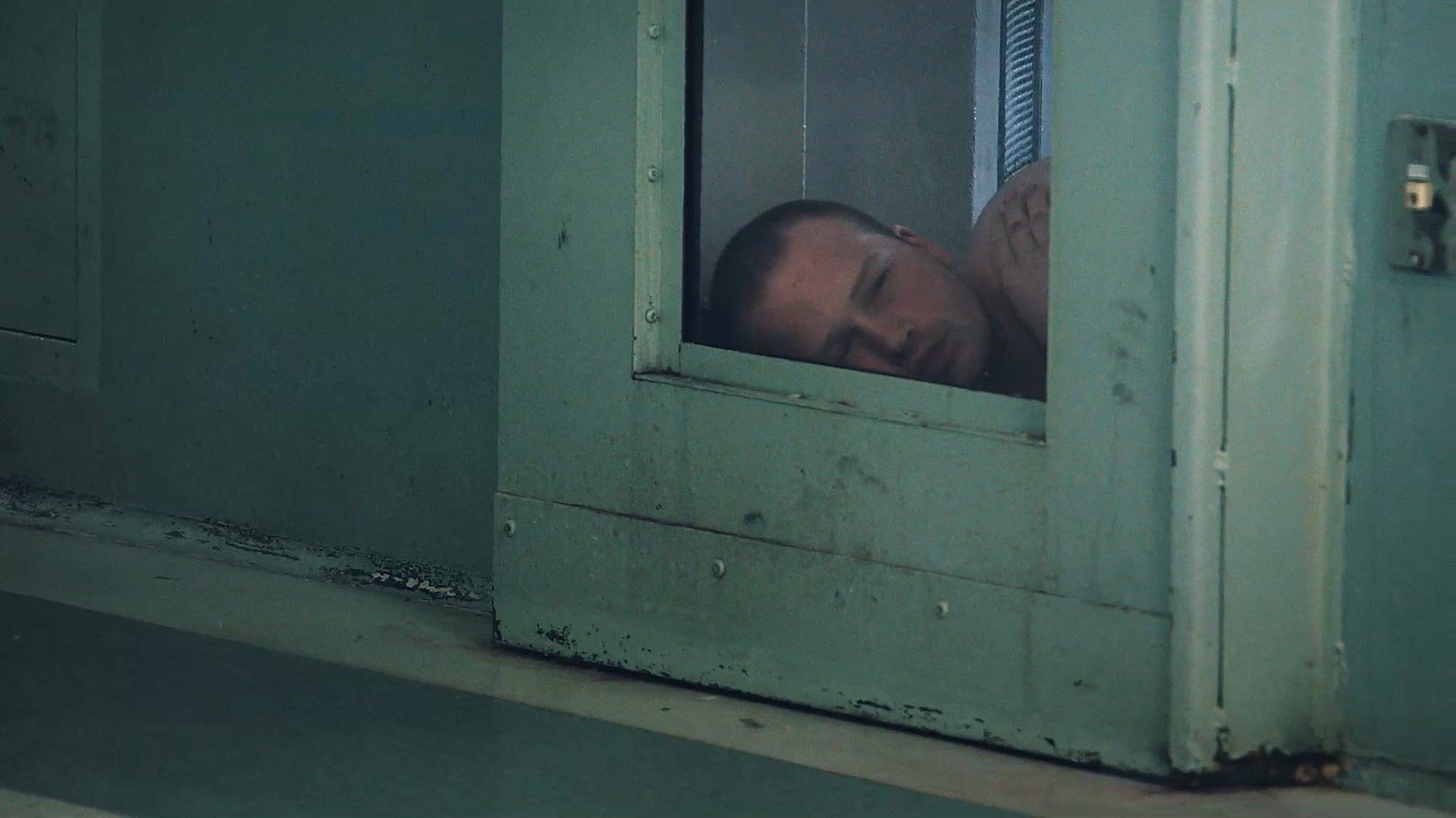 A Maine State Prison inmate inside his cell in the prison's Mental Health unit.