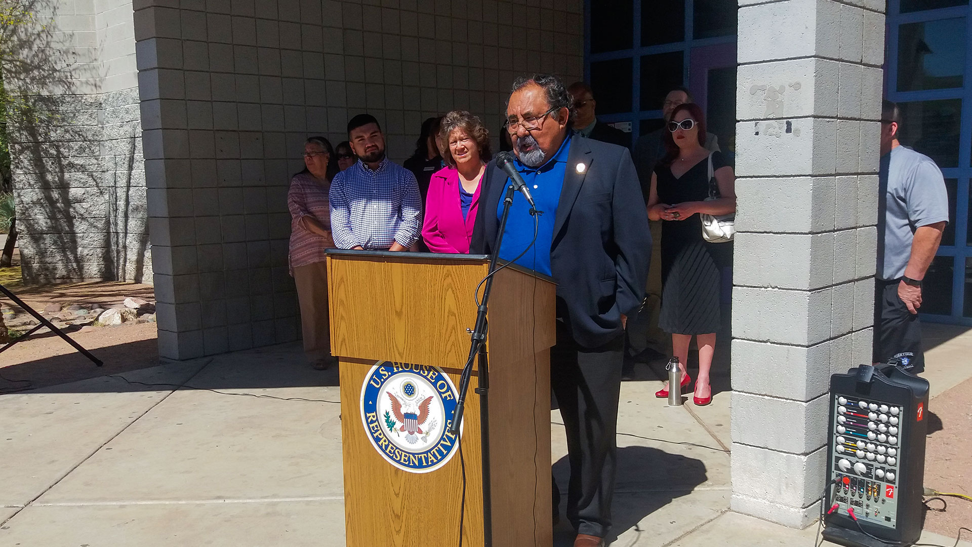 U.S. Rep. Raúl Grijalva speaks in front of El Pueblo Library in Tucson in support of funding for public libraries, facing cuts under a proposal from President Donald Trump.