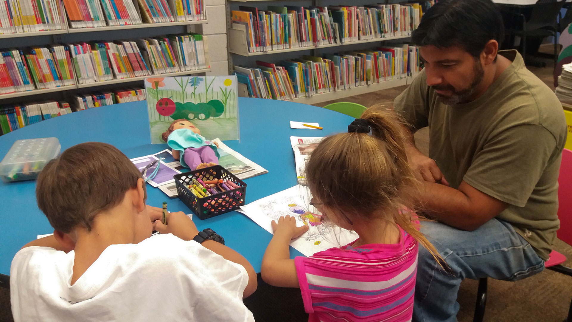 Man and kids in library unsized