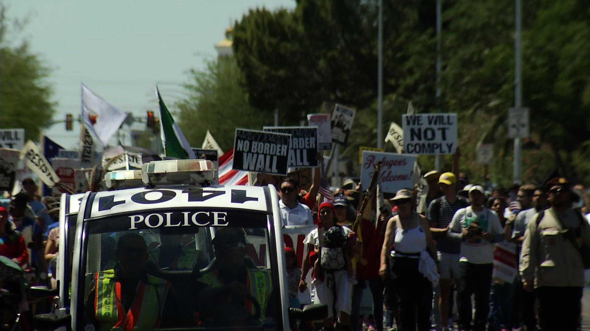 Three hundred demonstrators marched from Tucson's south side to Armory Park, May 1, 2017.