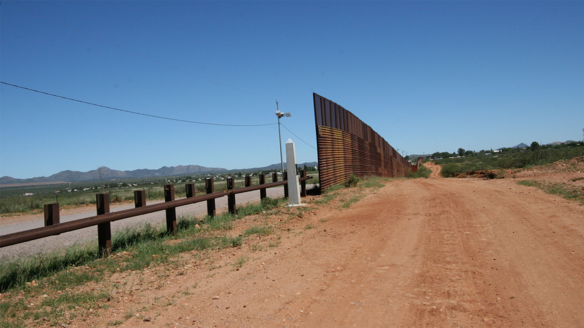The old border wall made of military landing platform that stood for years dividing Naco, Arizona, and Naco, Sonora.