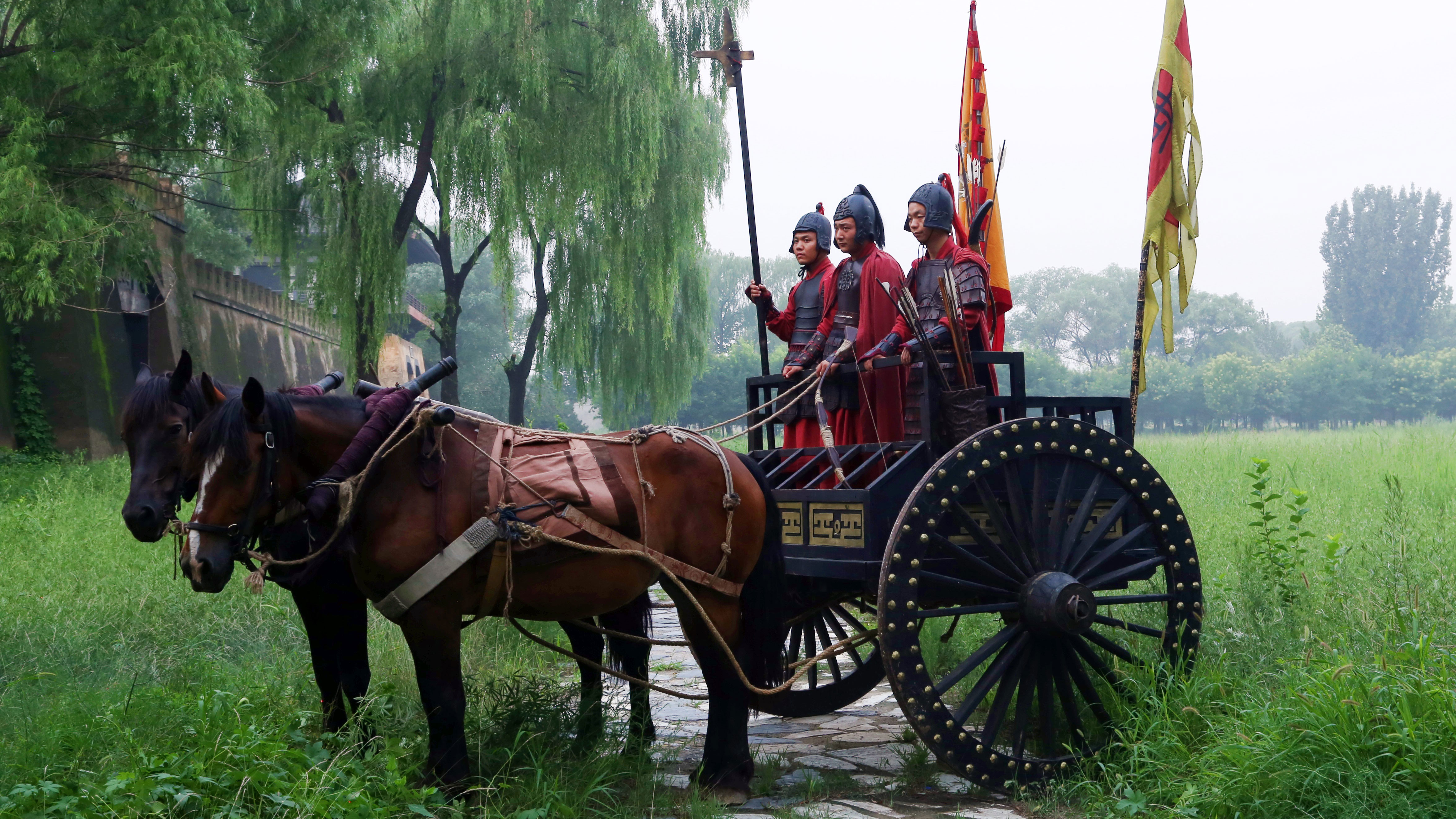 Actors dressed as ancient Chinese soldiers on chariot