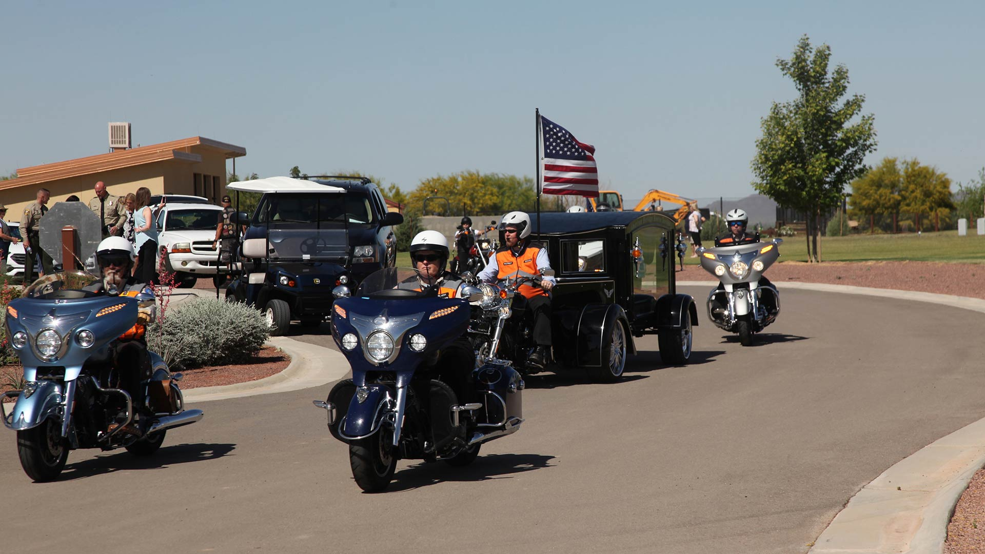 motorcycles lead hearse veteran memorial hero