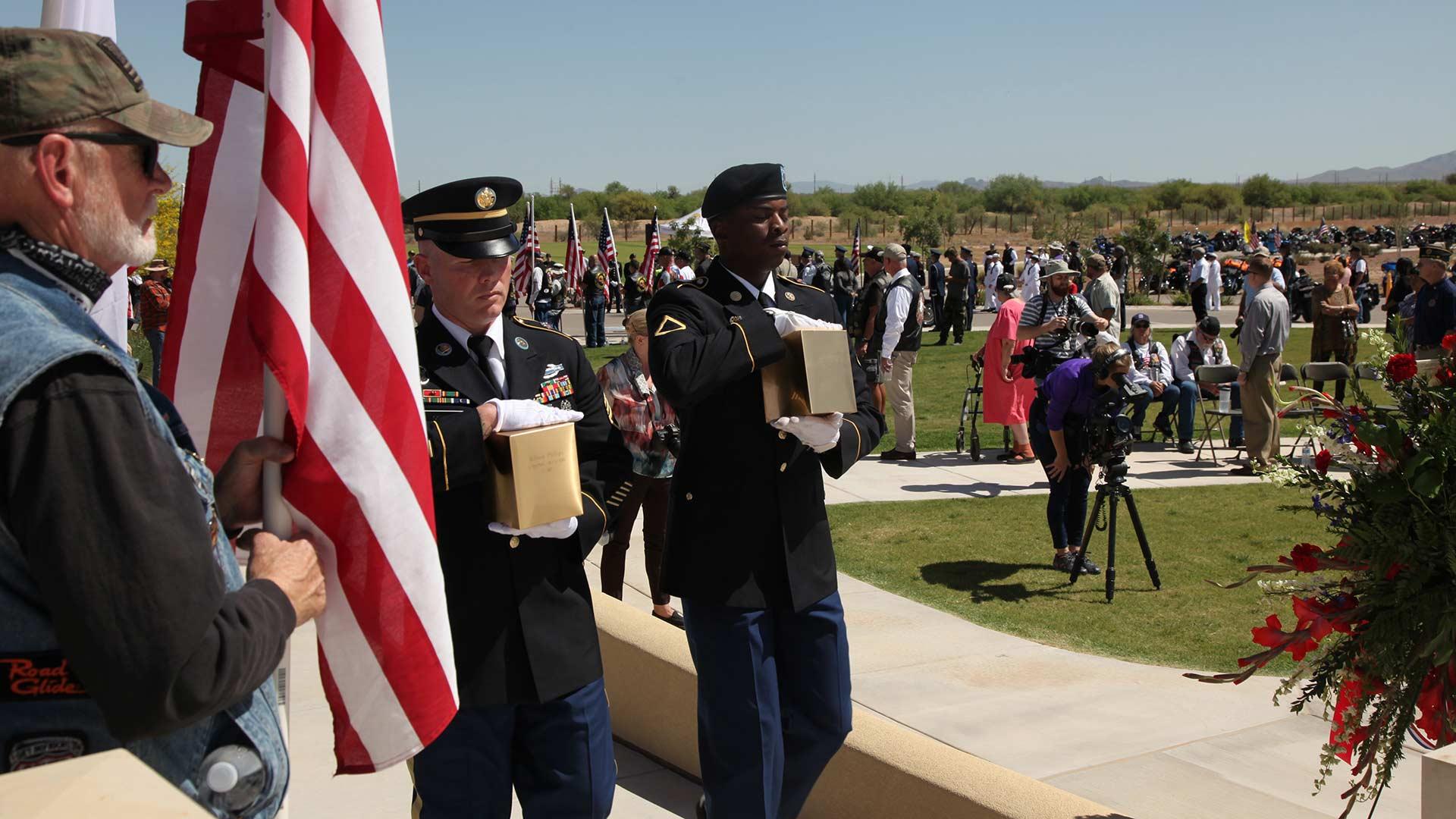 Honor Guard carry urns veteran hero