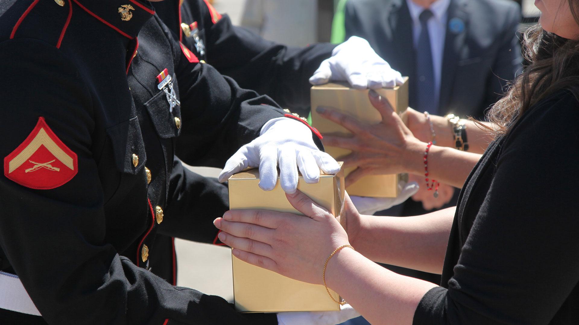 Urn handoff veterans hero
