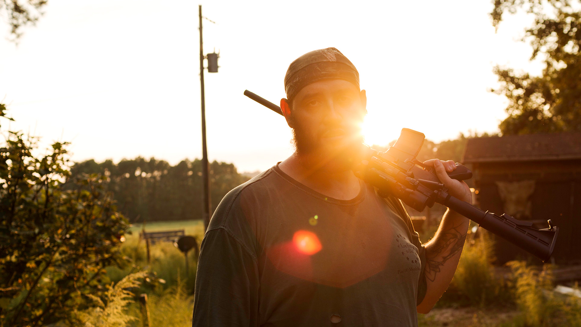 U.S. Army veteran Alex Sutton after shooting a rifle on his farm in rural Moore County, North Carolina, October 2, 2014.